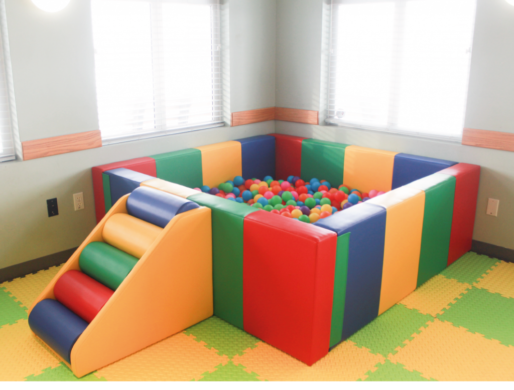 colourful ball pit. square. multi coloured step up. filled with multi colour balls